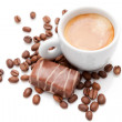 Small espresso cup with chocolate and coffee beans isolated on white — Stock Photo #35577057