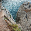 Old stone stairs goes down to the sea water — Foto de Stock