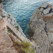 Old stone stairs goes down to the sea water — Stock Photo