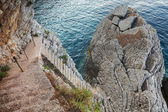 Old stone stairs goes down to the sea water — ストック写真