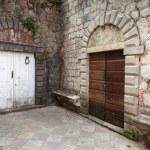 Wooden doors on the street of ancient Perast town, Kotor bay, Montenegro — Stock Photo #35981433