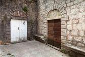 Wooden doors on the street of ancient Perast town, Kotor bay, Montenegro — Stock Photo