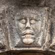 Bas-relief with man's face on ancient house facade in Perast town, Montenegro — Stock Photo