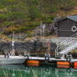 Small floating pier with moored motorboat in Norway — Stock Photo