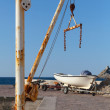 White fishing boat and small crane in port of Petrovac town, Montenegro — Stock Photo