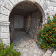 Stone arch, entrance to ancient house in Perast town, Montenegro — Stock Photo