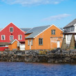 Traditional Norwegian village with colorful wooden houses on rocky coast — Stock Photo