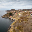 Traditional coastal Norwegian village with colorful wooden houses on rocks — Stock Photo