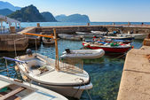 Fishing boats float moored in Adriatic sea water. Petrovac town, Montenegro — Foto Stock