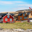 Norwegian village with colorful wooden houses on rocky sea coast — Stock Photo