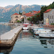 White wooden boats float moored in Perast. Kotor Bay, Montenegro — Stock Photo
