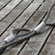 Mooring equipment on wooden pier. Steel rope — Stock Photo
