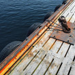 Stock Photo: Mooring equipment on wooden pier in Norway