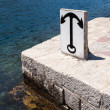 Anchor sign on stone embankment in Kotor bay, Montenegro  — Stock Photo