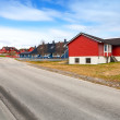 Rural Norwegian landscape with asphalt road and wooden houses — Stock Photo