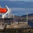Red rescue boat on the coast in Norwegian town — Stock Photo