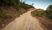 Rural road goes up on the mountain in Montenegro — Foto de Stock
