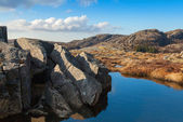 Small still lake and stones in Norwegian mountains — Stock Photo