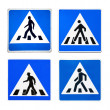 Pedestrian crossing signs from different countries — Stock Photo