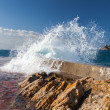 Stone breakwater with breaking waves. Adriatic Sea, Montenegro — Stock Photo