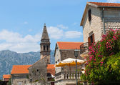 Bell tower of St. Nicholas Church in Perast town. Bay of Kotor — Stock Photo