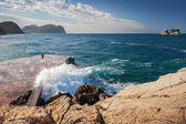 Stone breakwater with breaking waves. Montenegro, Adriatic Sea — Stock Photo