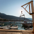 Small marine crane in port of Petrovac town, Montenegro — Stock Photo