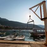 Small marine crane in port of Petrovac town, Montenegro — Stock Photo #37292711