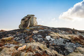 Stone cairn as a navigation mark on the top of Norwegian rock — Stock Photo