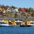 Norwegian fishing village with wooden houses on the sea coast — Stock Photo #37739277