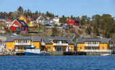Norwegian fishing village with wooden houses on the sea coast — Stock Photo