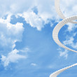 White spiral stairs goes up in blue cloudy sky — Stock Photo #37810611