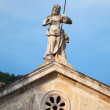 Jesus statue on the rooftop of ancient church in Perast — Stock Photo