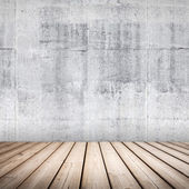 Empty concrete interior background with wooden floor — Stock Photo