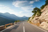 Mountain highway with dividing line in Montenegro — Stok fotoğraf