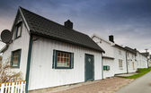 Street with white wooden houses in small Norwegian town — Stock Photo