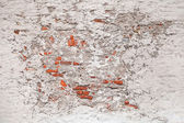 Background texture of old damaged brick wall with white stucco — Stock Photo