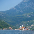 Bay of Kotor, Montenegro. Mountains and small island with old ch — Stock Photo #38556821