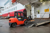 Big passenger ferry loading with lift truck — Stock Photo