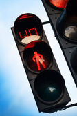 Red stop signal with timer on street pedestrian traffic light — Stock Photo
