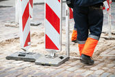 Road under construction. Restricted area signs and workers — Stock Photo