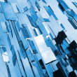 Foto Stock: Abstract blue mirrors background above sky