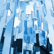 Foto Stock: Abstract blue glass mirrors background above sky