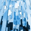 Foto de Stock  : Abstract blue glass mirrors background above sky