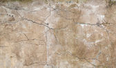 Background texture of old yellow wall with stucco and cracks — ストック写真
