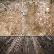 Old grunge interior background with concrete wall and wooden floor — Stock Photo