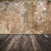 Old grunge interior background with concrete wall and wooden floor — 图库照片
