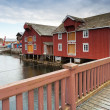 Stockfoto: Red wooden houses in small Norwegifishing village