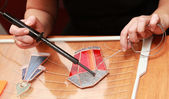 Stained glass maker works with red lamp souvenir — Stock Photo