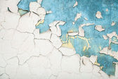 Texture of old white cracked paint on blue concrete wall — Stock Photo